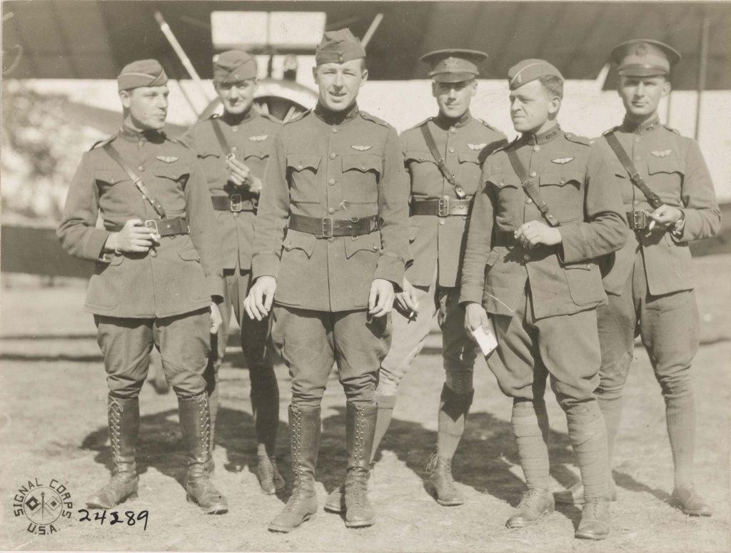 Photo of six men in uniform.