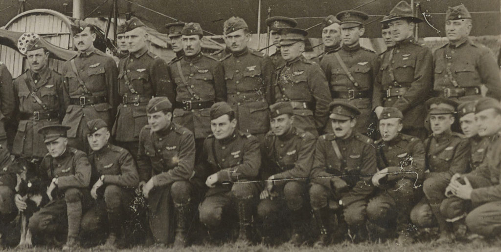 Photo of about 25 men in uniform, nearly all with pilot's wings.