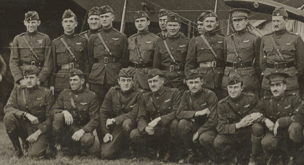 Photo of 18 men in uniform with pilot's wings on their chests.
