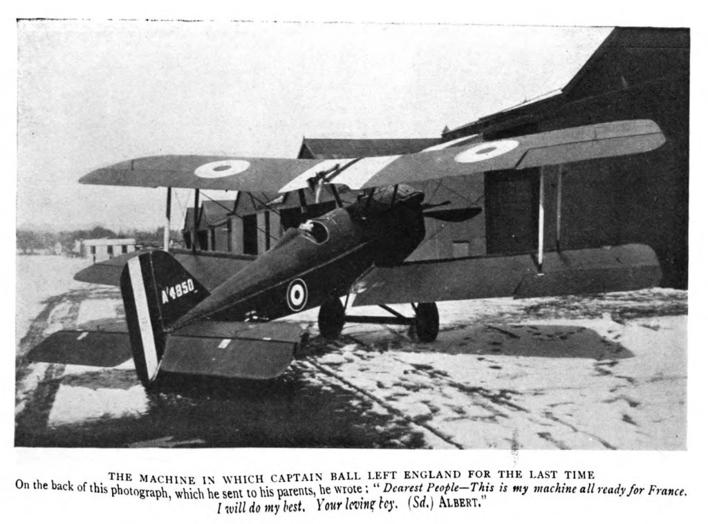 "Photo of a plane, with the serial number A4850 on its tail, with a man visible in the cockpit. The caption reads in part ""The machine in which Captain Ball left England for the last time."""