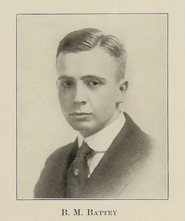 Formal portrait, head and shoulders, of a man in a suit in three quarter profile.