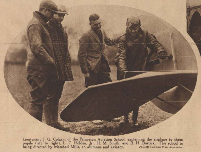 A Newspaper clipping showing a photo of four men peering at the wing of a plane. The caption identifies them as Lt. Colgan of the Princeton Aviation School, and three pupils: L. C. Holden, Jr., H. M. Smith, and B. H. Bostick.