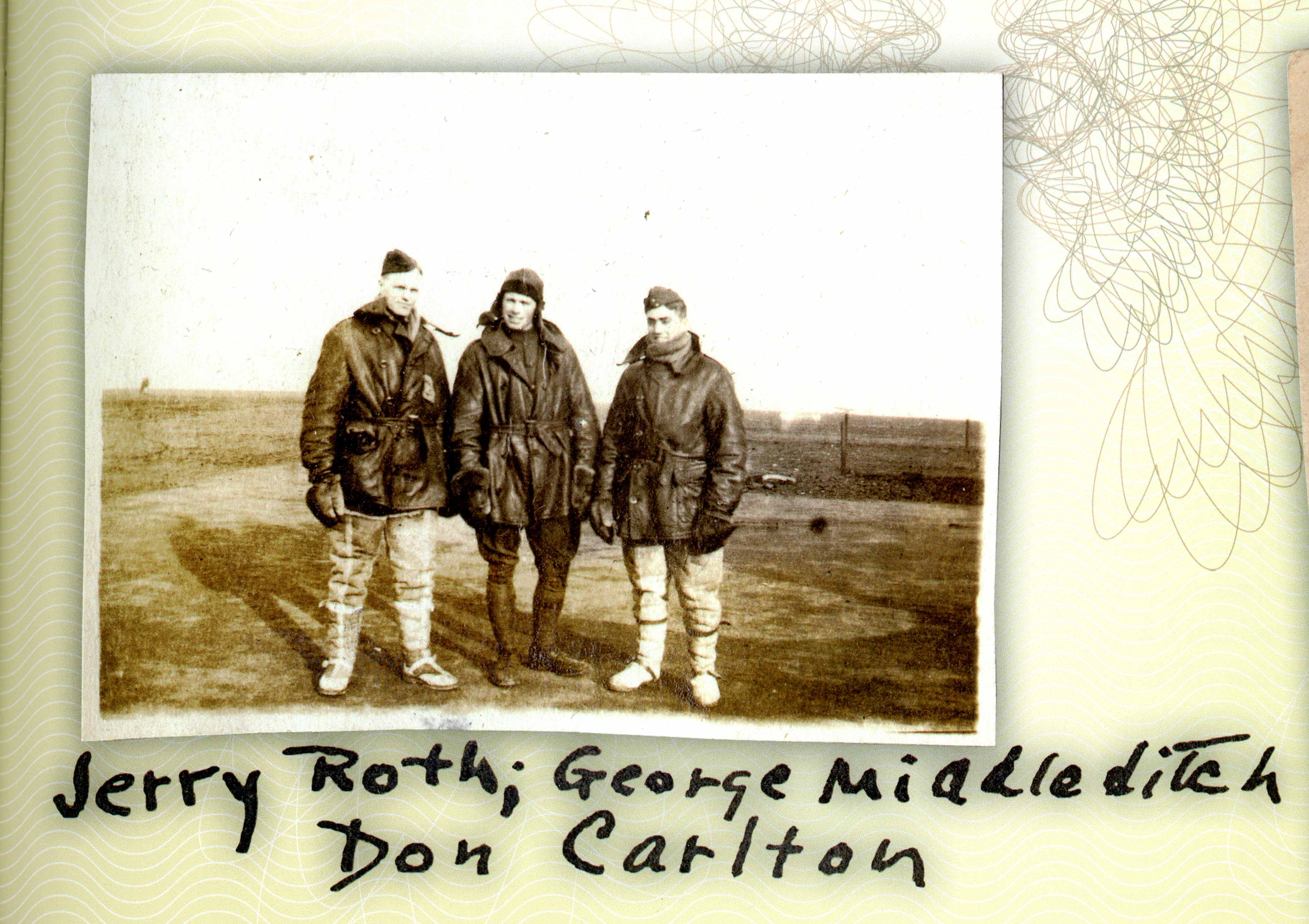 A photo of three men in flying clothes in a field.
