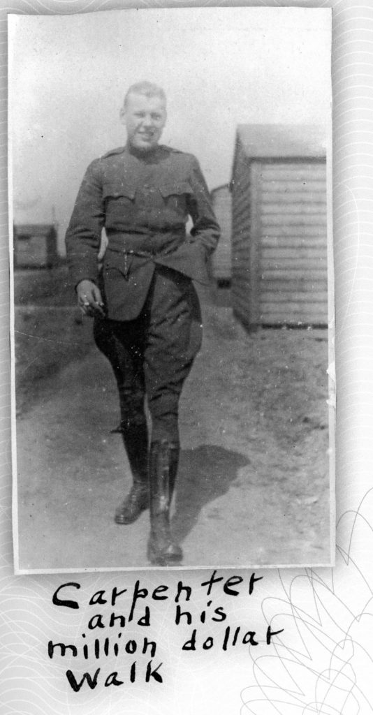 """A hatless man in a uniform devoid of insignia striding towards the camera, captioned """"Carpenter and his million dollar walk."""""""