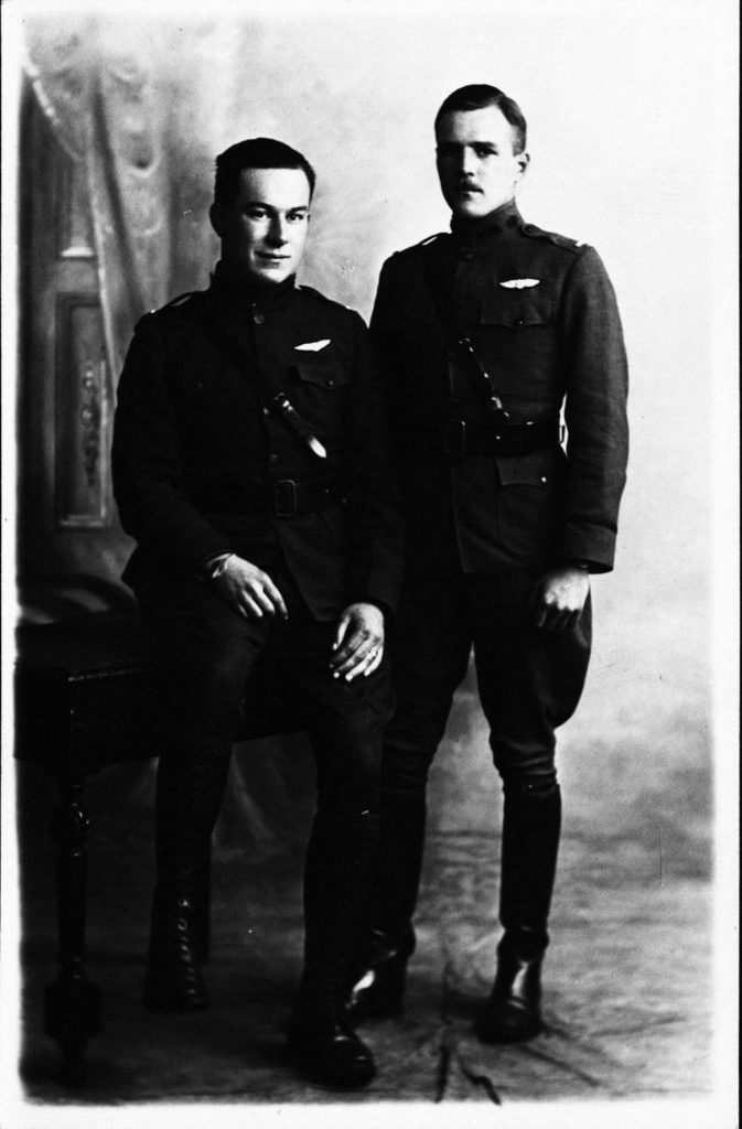 A formally photo of two men in uniform with pilot's wings. Shaw is recognizable on the left, Deetjen on the right.