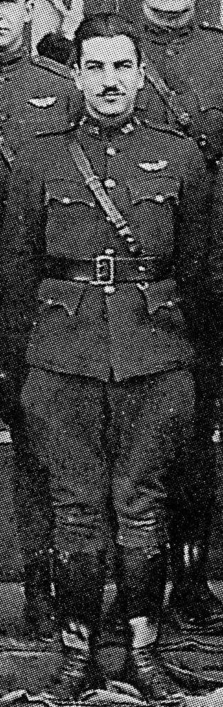 Detail from a rather grainy photo showing a hatless man, Desson, in uniform with pilot's wings over his left breast pocket.
