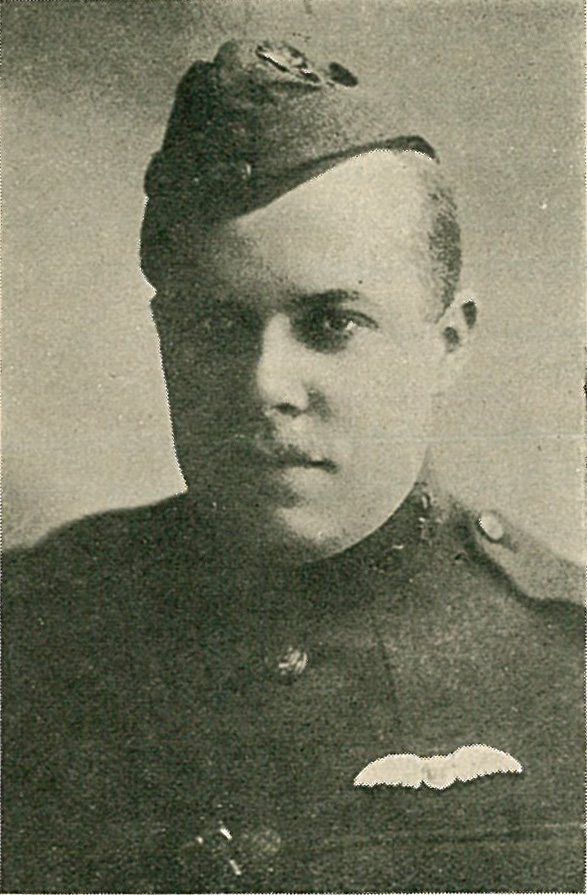 Photo of Griffith, head and shoulders, wearing an R.F.C. cap and with pilot's wings above his left breast pocket.