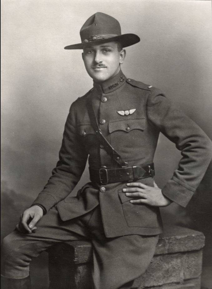 A portrait photo of Hamilton in uniform wearing a campaign hat and Sam Browne belt, with pilot's wings and lieutenant's bars.
