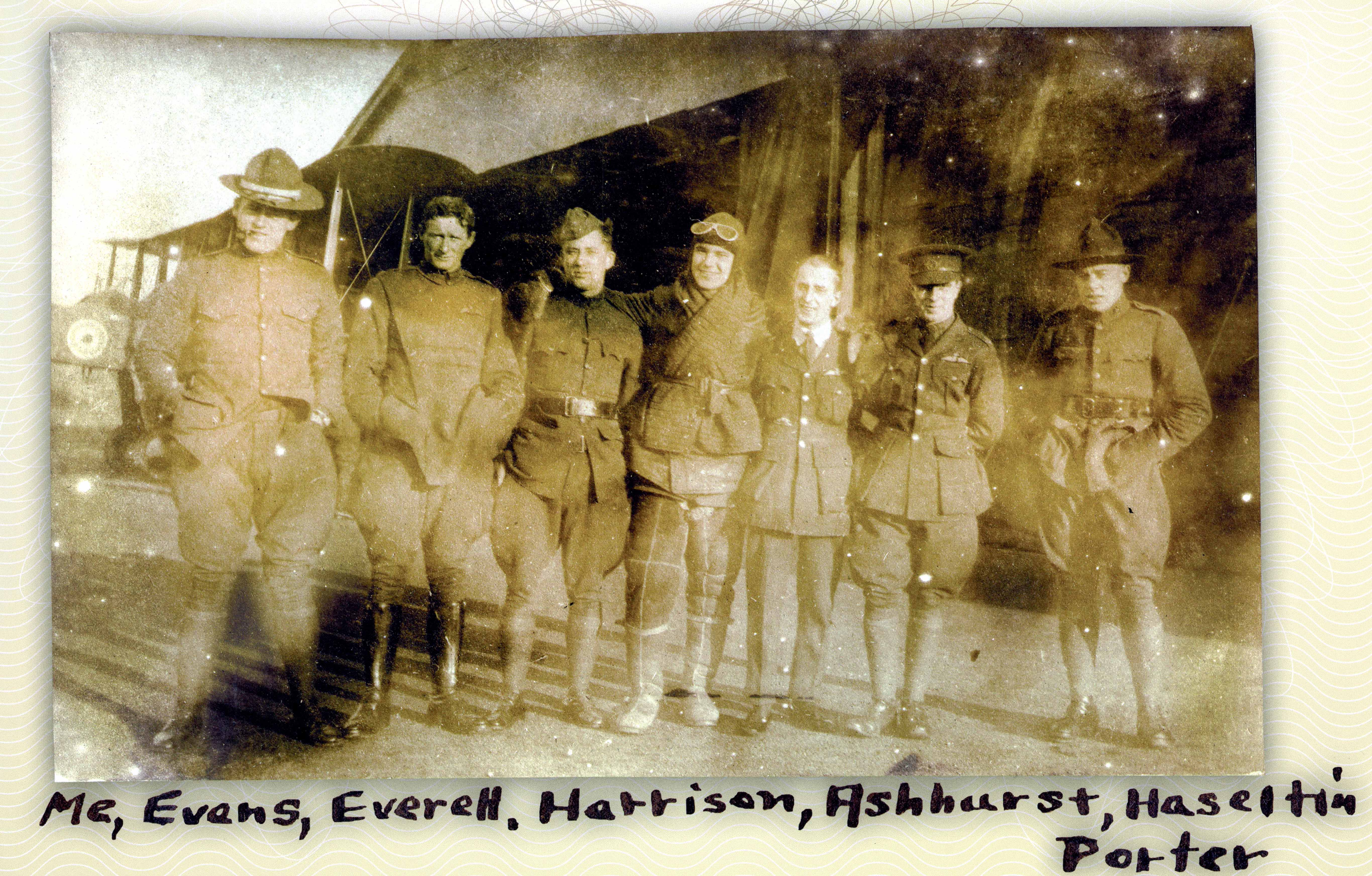A photo of seven men, two of whom, by the wings on their chests, are officers and pilots; identifications are written in ink below the photo.