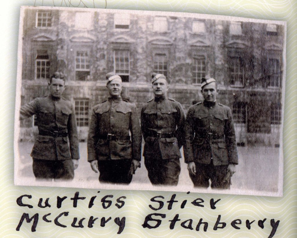 Four men in uniform at Oxford.