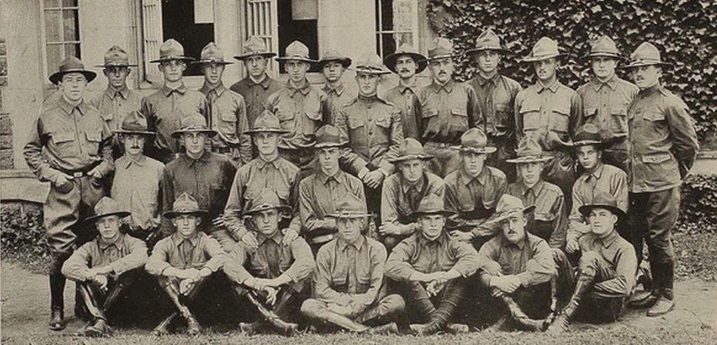 Photo of 29 men in uniform wearing campaign hats, arranged in three rows; the men in the front row are sitting, the men in the middle and back rows are standing.